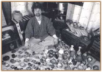 Robert Yellin sitting in his pottery room