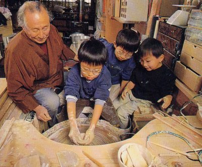 Yukoan playing with grandchildren