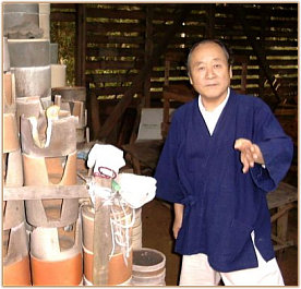 Kato Kozo in front of His Kiln